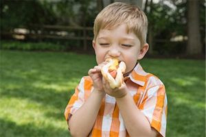 kids enjoy hotdogs