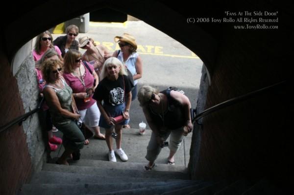 fans at the side door - Ryman Auditorium in Nashville - by Tony Rollo
